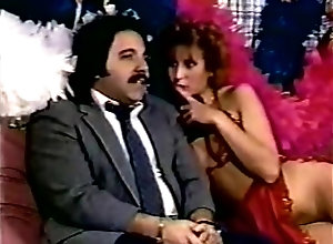 Latin,Asian,Aja,Jade East,Sasha Strange,Scarlett Scharleau,Vanity,Ron Jeremy,Scott Irish,Tony Montana,Italian Stallion Risque Business